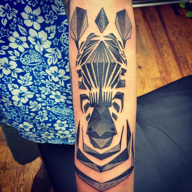 Geometric zebra tattoo by @chriskelleytattoos