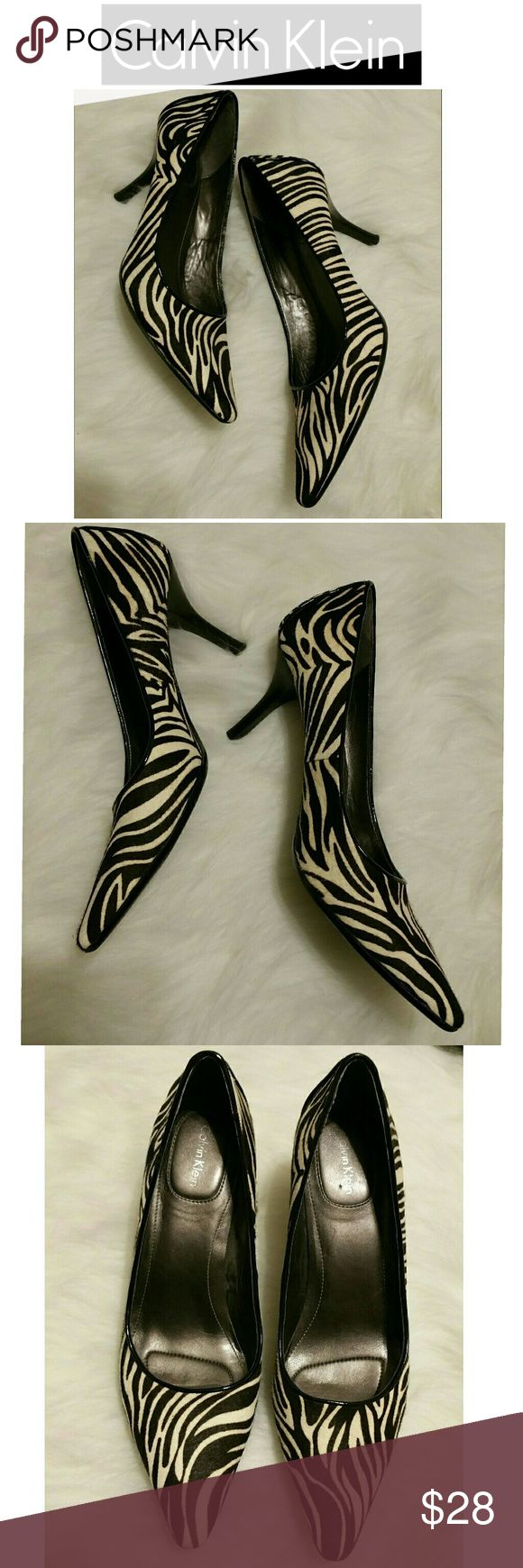 SALE!!  Calvin Klein Dolly Zebra Pumps Super pretty!  The zebra fur is soft and in perfect condition.  These pumps are perfect to add a little POP to your outfit!   Calvin Klein heels are among the most comfortable heels I've ever worn. Calvin Klein Shoes Heels