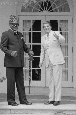 Washington, D.C.: President of Zaire, Mobutu Sese Seko, holding his walking stick, and President Reagan pose for photographers in the rose garden before a meeting at the White House. August 04, 1983