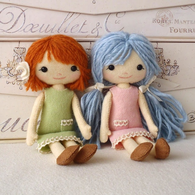 Handmade dolls. Would be cute to have our own mini Living Dolls!