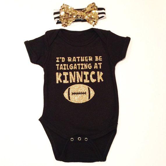I'd Rather be tailgating at Kinnick onesie. Iowa Hawkeyes. Iowa. Iowa Hawkeye Football. Gold. Glitter. Baby shower. Iowa Onesie. Iowa Tee.