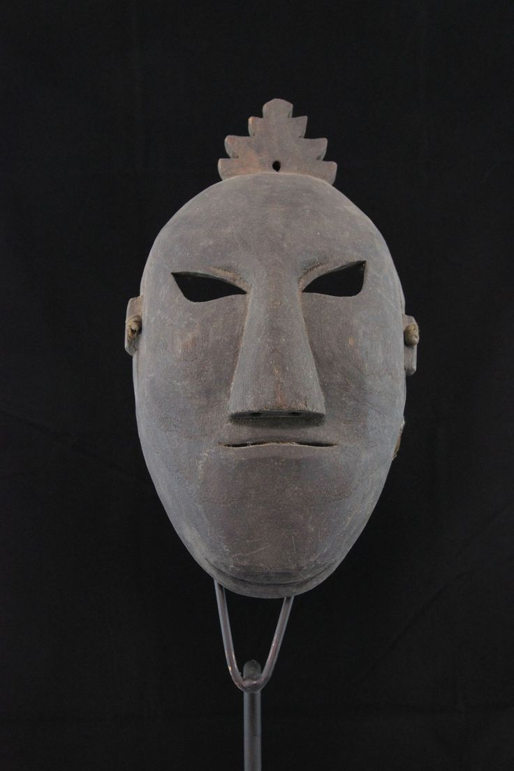 Nuo Mask. The Yao people make masks that are usually all black and quite dramatic in their primitive simplicity. This one has only a small top-knot and beard for decoration. Much less colorful than the Maonan Nuo masks, these imposing masks are used for shamanistic rituals.