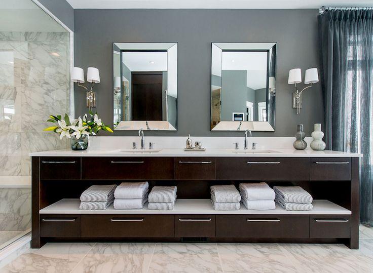 Dreamy bathroom with dark gray walls pairing with floor length gray draperies.