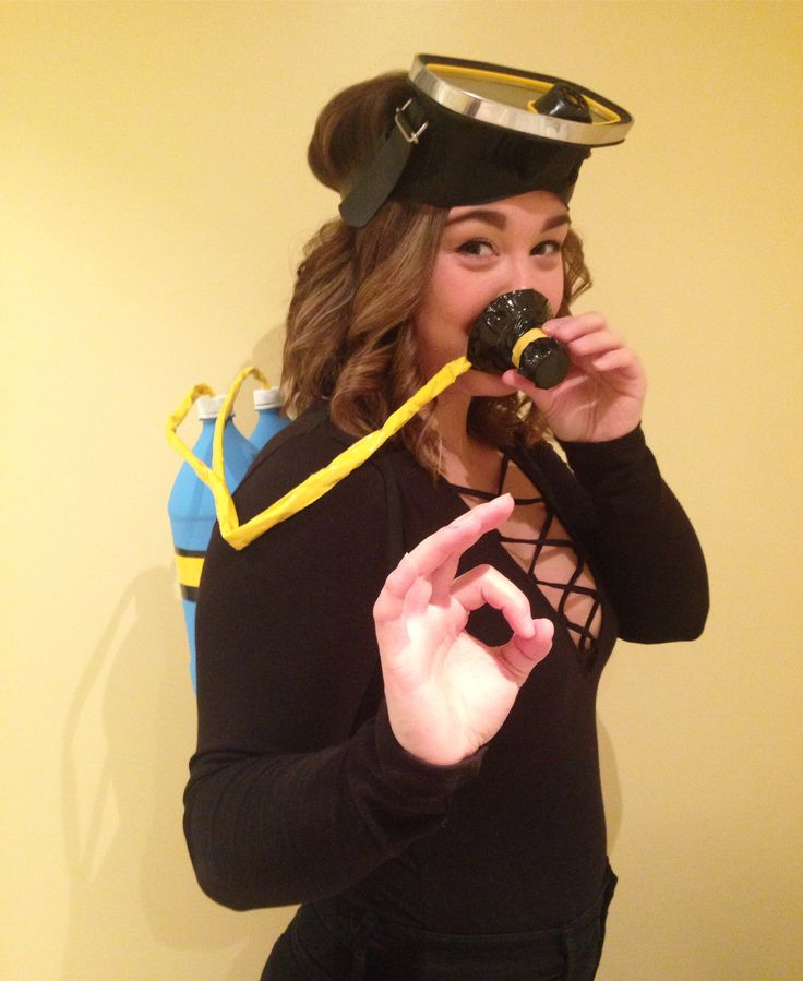DIY Scuba Diver costume!  Two 2L bottles, painted with two coats of acrylic paint. Black electrical tape and yellow duct tape to creat the lines on the bottle. Hockey tape with yellow duct tape around it to make tubing. The top of another 2L bottle is cut off and covered with black duct tape to make the mouth piece!