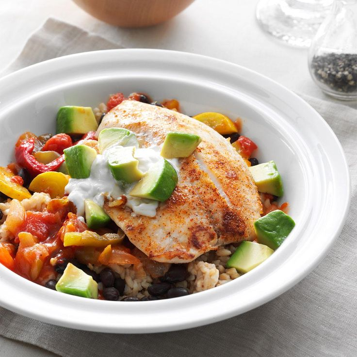 Spicy Tilapia Rice Bowl Recipe -I love healthy living and tilapia is a staple in my kitchen. Fresh vegetables are always good but take more prep time, so I use boil-in-bag rice for a shortcut. —Rosalin Johnson, Tupelo, Mississippi