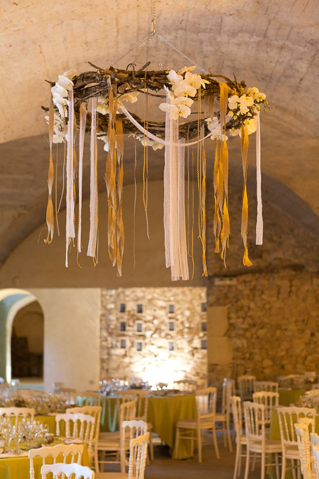 Beautiful ribbon, flower, and grapevine chandelier - would rock as an altar too : )