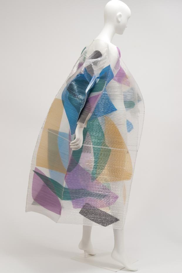 Coat  Issey Miyake, 1994. Layering of different fabrics, levels of sheer