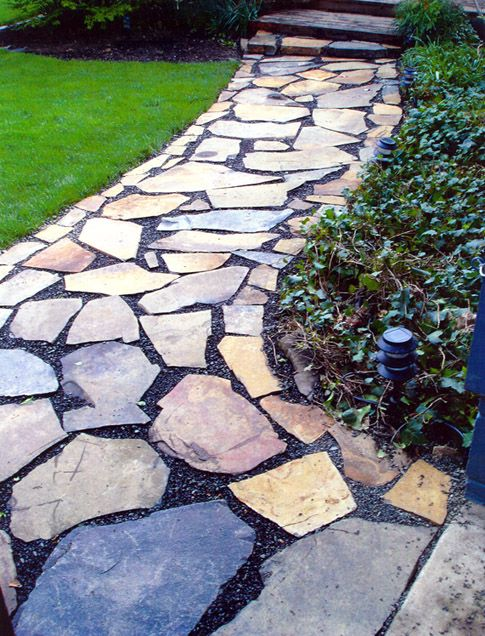 Landscaping with stones and rocks stepping stone path for Stone stepping stones for garden paths