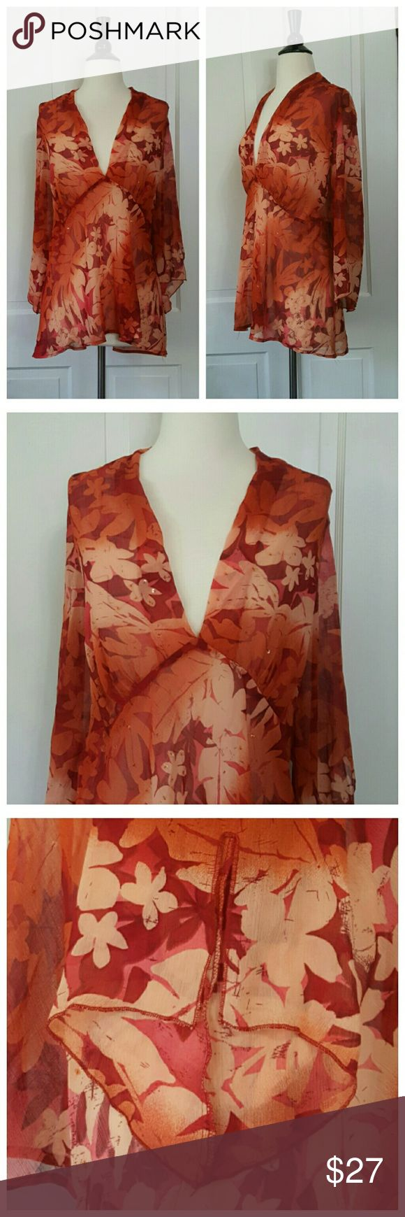 New York City Design Orange And Rust Top New York City Design sheer v-neck top, long sleeves with a slight bell and slit at wrist. A very light scattering of pale orange beads and sequins. New York City Design Tops