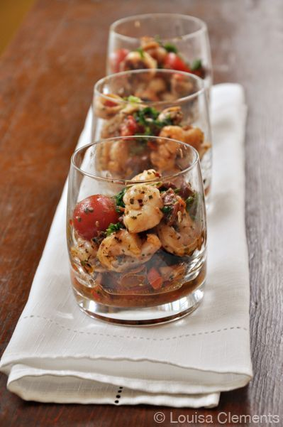 The perfect make-ahead appetizer for entertaining, this seafood salad is made with a combination of shrimp, scallops, mussels, fresh tomatoes and basil.