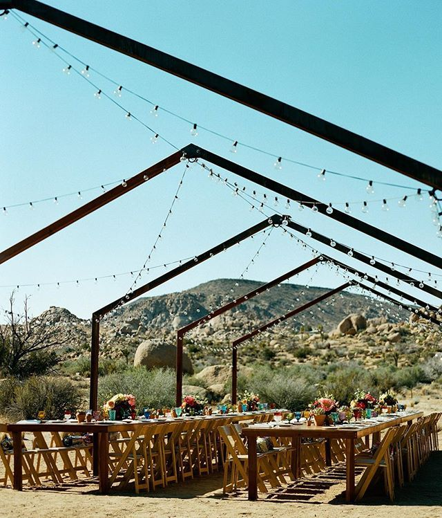 A closer look at the rad reception area from today's Joshua Tree wedding at @theruinvenue - such a dreamy place to dine with your closest family & friends, right?! Tag someone you'd love to dine with under the stars ✨ photog: @_benchristensen | venue: @theruinvenue | florals: @bloombabes | makeup: @novakaplan | paper goods: @joshariza | catering: @sohotaco | desserts: @laurenlowstan | rentals: @otisandpearl @thriftedsisterevents #dineunderthestars #joshuatreewedding #onGWS