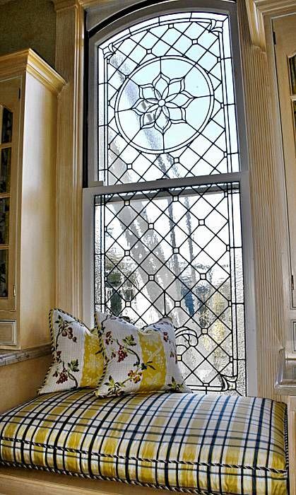 Window seat with leaded glass window.