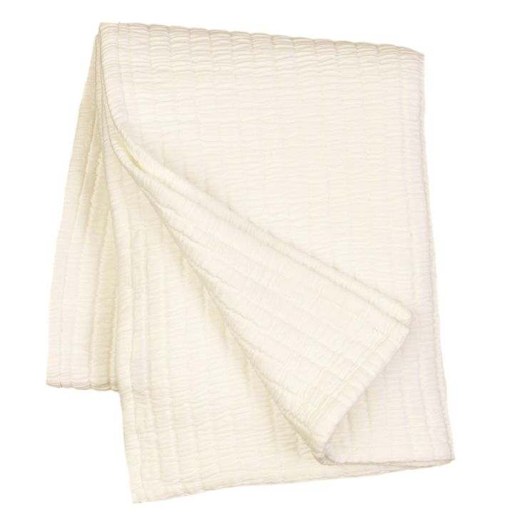 """You asked for it, and we couldn't help but deliver! Introducing our coziest cotton matelasse yet, now in a portable, 50"""" x 70"""" throw! In a classic creamy ivory, this ultrasoft cotton matelasse throw can be draped over the foot of the bed for an extra layer of warmth, or tossed over a chair or couch for an instant style upgrade.    • 100% cotton.   • 1"""" hem/flange.   • Made in Portugal."""