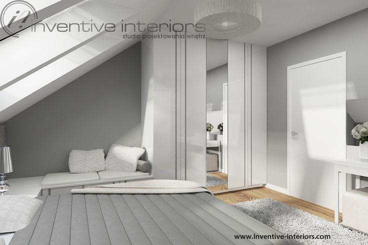 Projekt pokoju gościnnego Inventive Interiors - biała szafa z wpuszczanymi uchwytami i lustrem