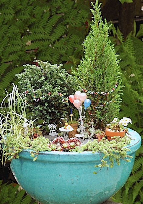 Unique and Creative Fairy Gardens • Lots of Tips and Ideas! Including, from 'janet calvo', this wonderful mini fairy garden. Love the balloons!