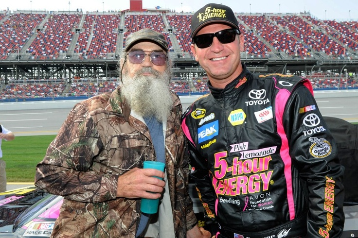 Clint Bowyer poses with Duck Dynasty's Si Robertson on the grid during qualifying. - Still got that cup!