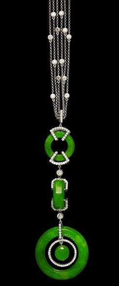 A jadeite and diamond disc necklace The pendant set with three bright green jadeite hoops of good translucency, the largest measuring approximately 28.4mm x 5.3mm, and suspending a jadeite disc within, all joined by highly articulated brilliant-cut diamond-set links, and suspended from a three-row chain with spectacle-set brilliant-cut diamond accents, the diamonds estimated to weigh approximately 2.20 carats in total, pendant length 9.2cm, necklace length 41.0cm