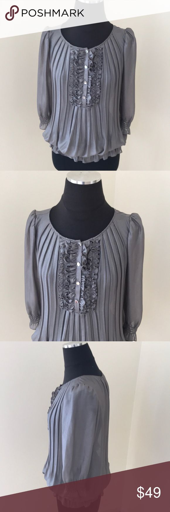 Ted Baker metallic Ruffled Pleated Top Ted Baker Metallic Ruffled Top , pleated and Ruched at Sleeve ends and at top end. Has an unnoticeable stain at the back as shown in last pic but otherwise in beautiful condition . Ted Baker London Tops Tees - Short Sleeve