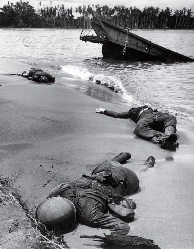 Three American soldiers lie half-buried in the sand at Buna Beach on New Guinea. This photo was taken in February 1943, but not published until September, when it became the first image of dead American troops to appear in LIFE during World War II. George Strock's photo was finally OK'd by government censors, in part because FDR feared the public was growing complacent about the war's horrific toll.