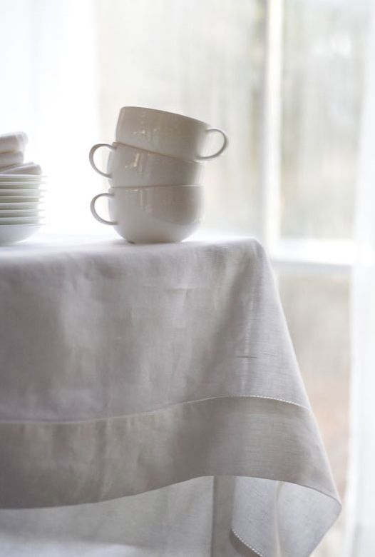 white linen table cloth & large coffee cups
