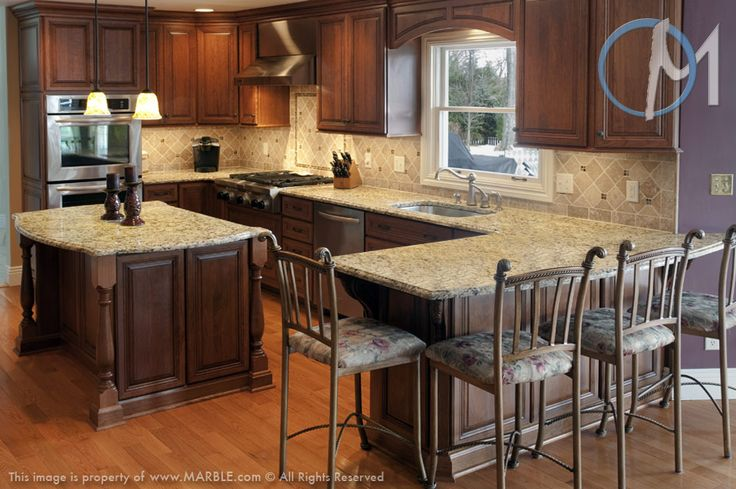 Santa Cecilia Featured Throughout This Kitchen Provides A