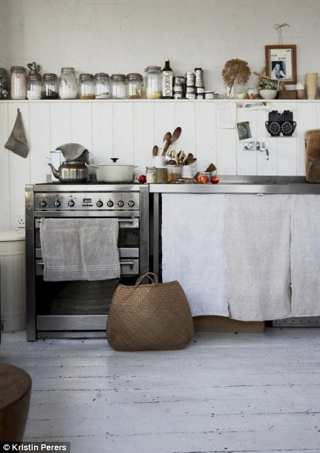 Look at the old linen covering the front of the industrial style shelves.  Kristin Perers Home