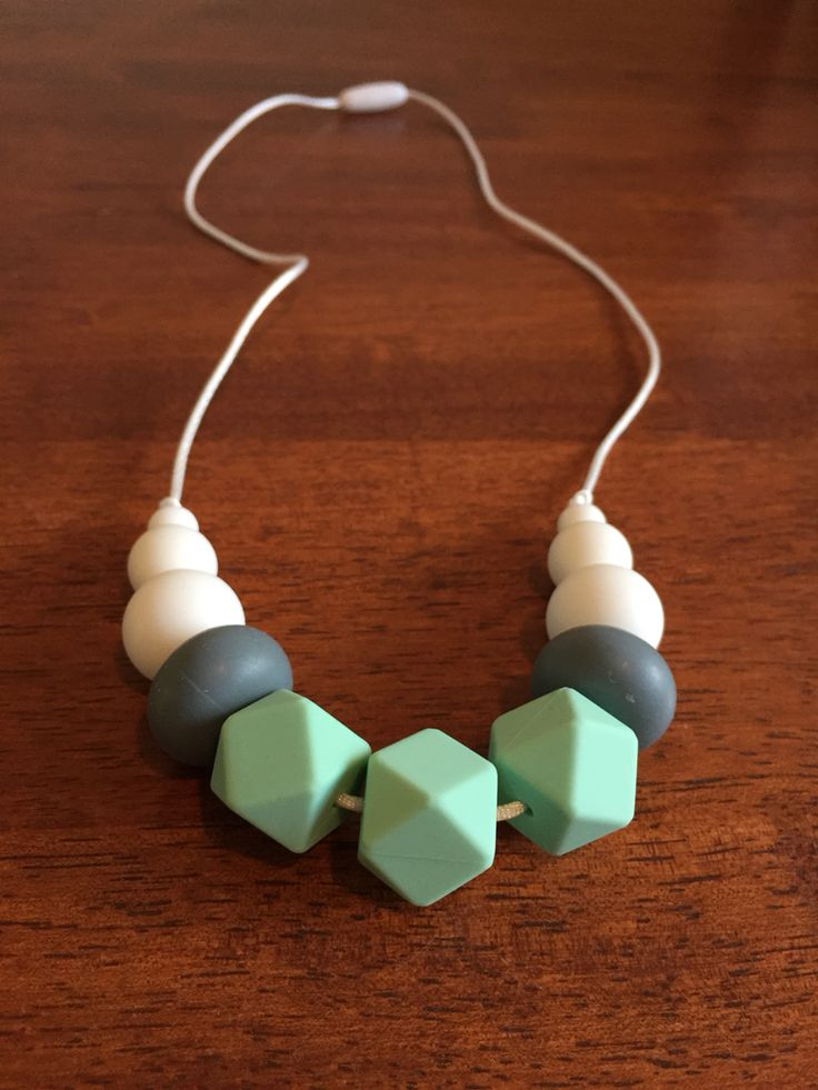 Silicone Teething Necklace- Fussy Little Fox Hexagon/Abacus Teething Necklace in mint, grey and white on white nylon cord with white safety catch. $20 + Free Shipping within Australia. Visit Fussy Little Fox on Facebook to see more or email fussylittlefox@gmail.com to purchase