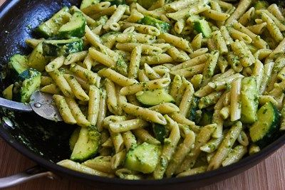 Easy Penne Pasta with Zucchini and Basil Pesto  (Makes about 6 servings; recipe created by Kalyn)    Ingredients:  1 box (13.25 oz.) Dreamfields Penne (or use any short, tubular pasta of your choice)  salt, for pasta cooking water  2 medium zucchinis (8-10 inches long) cut into half-moon shapes  1 T minced fresh garlic  1 T olive oil  salt and fresh ground black pepper, for seasoning zucchini  2/3 cup Basil Pesto with Lemon (or use any basil pesto of your choice; use more or less pesto to…