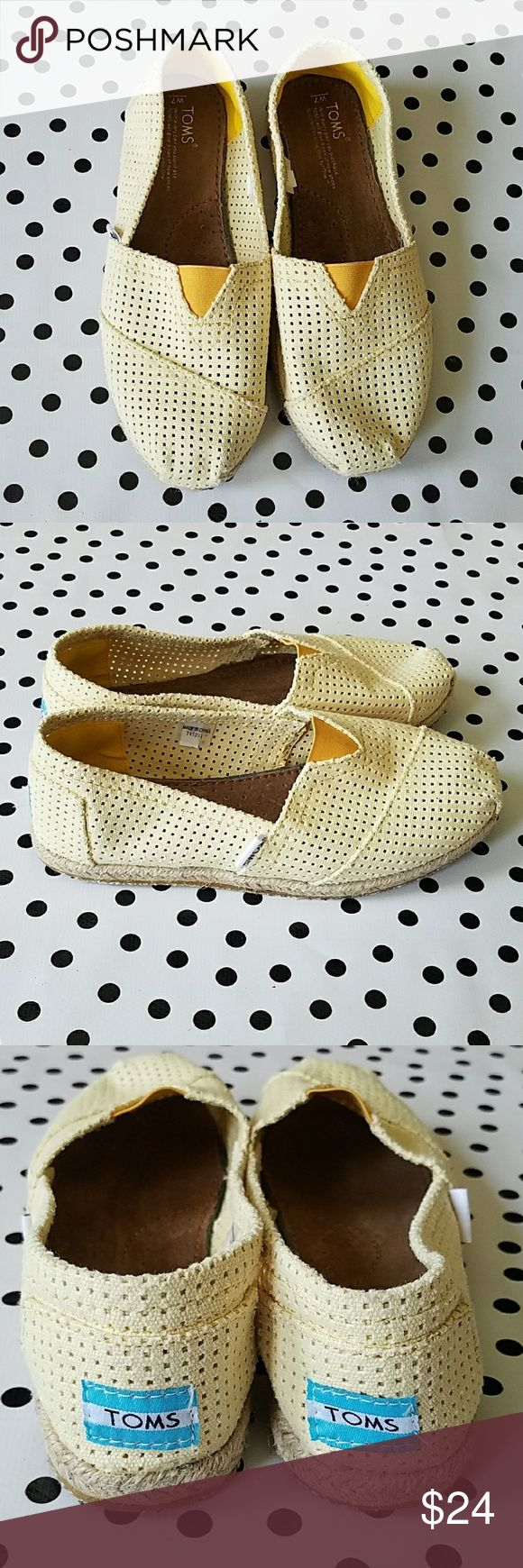 TOMS Freetown Classics Espadrille Slip-On TOMS Freetown Classics Espadrille Slip-On Perforated canvas shapes an airy, lightweight slip-on set on a summery, espadrille sole. Jute wrapped sole.  Elastic goring at instep. Cotton upper/suede insole/rubber sole. Butter yellow. Size 7. Very good used condition. No flaws,? minor surface dirt on soles. TOMS Shoes