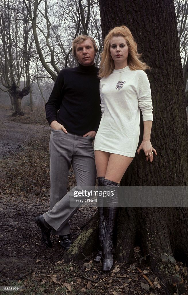 England football captain Bobby Moore (1941-1993) with his wife Tina, who is wearing an England football shirt, circa 1972.