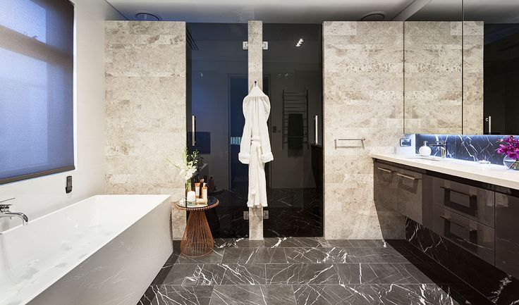 Luxurious master ensuite with freestanding soaker tub and custom designed cabinetry by Urbane Projects, Perth
