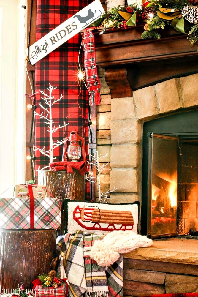 Sleigh ride Christmas mantel decor with antique snowshoes, toboggan, birch logs and plaid