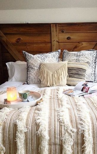 Hate the comforter, but I like the use of the wood mixed with bright colors.