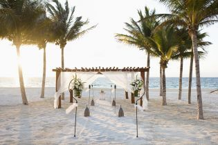 Destination wedding on the beach at Excellence Riviera Cancun, adults-only all inclusive resort in Mexico