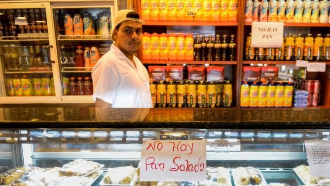 "A sign reading ""No Bread"" is displayed at a bakery in Caracas, an increasingly common sight at Venezuelan bakeries"