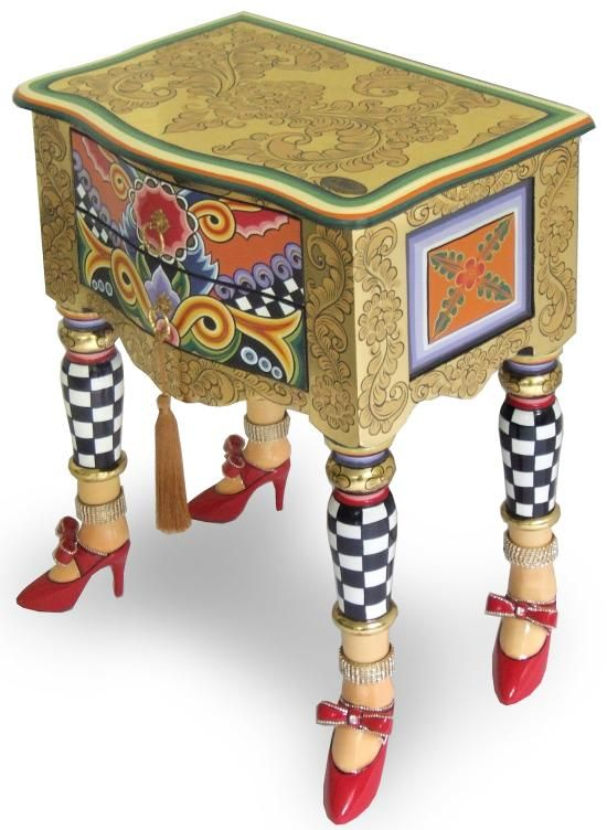 Making the most of a side table or other furniture with ugly legs. Living Color: Photo