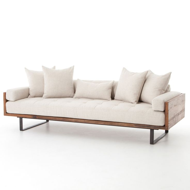 Organic and refined, the Ranger Sofa with Reclaimed Wood Frame and rough iron, upholstered with a soft, durable fabric exudes a laid-back luxury.(https://www.zinhome.com/ranger-industrial-loft-reclaimed-wood-sofa/)