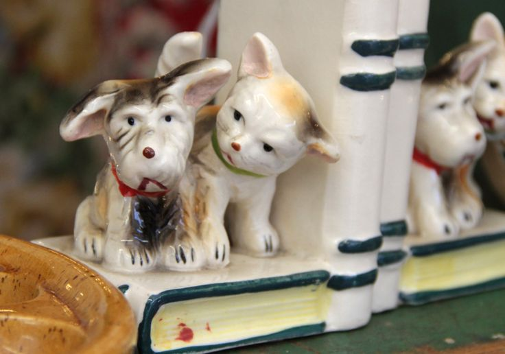 The best kind of bookends.  Vintage china - adorable. Hay-on-Wye