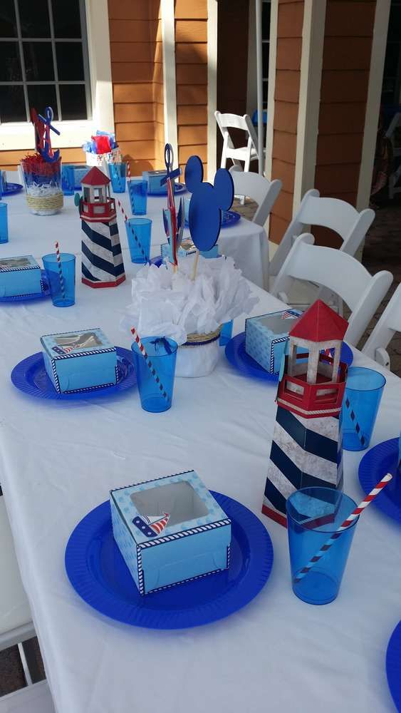 Nautical birthday party table place settings!  See more party planning ideas at CatchMyParty.com!