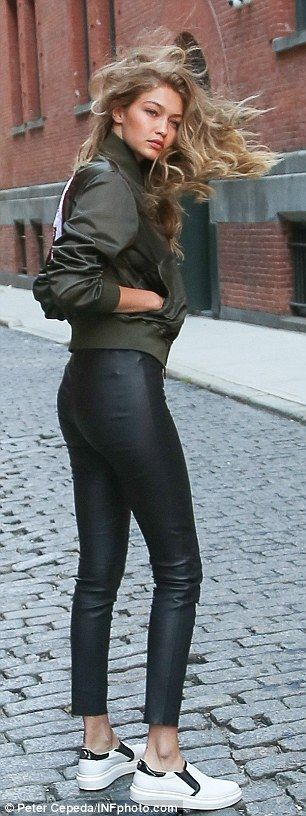 On-trend:Over the racy top, she sported an olive green on-trend jacket featuring a huge H...