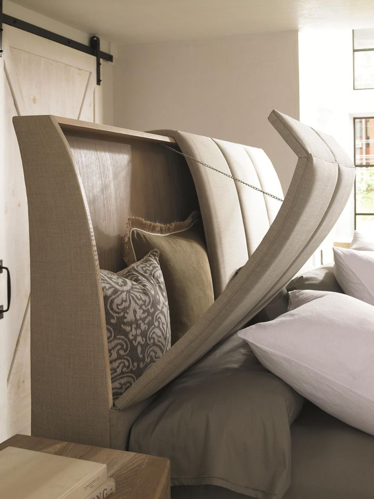 Has a hinged headboard for storage and a hidden spot in the footboard for the tv! Perfect!