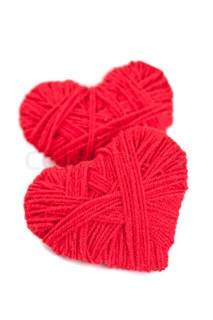 Image of 'two red thread hearts isolated on white background'