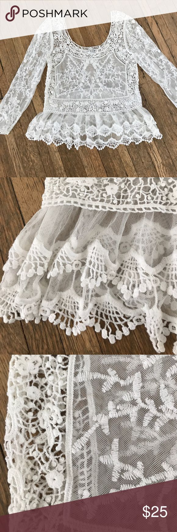 EUC Beautiful White Lace and Crocheted Boho Top Beautiful boho white lace top with crocheted details. Low scoop neck and two tiers of ruffles at the bottom with eyelet trim. Sleeves are 7/8th length. Express Tops Blouses