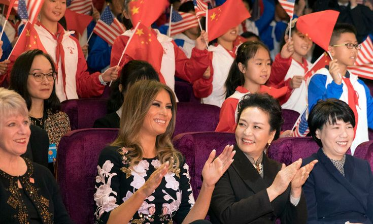 Donald Trump's wife could not contain her excitement as she watched the students' performance at the Beijing school November 9. Melania was pictured smiling and applauding.