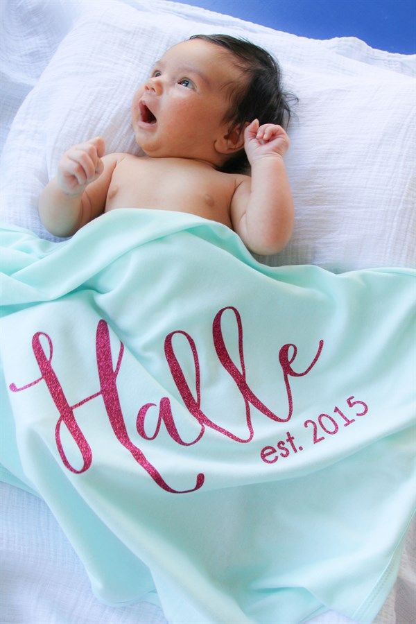 """Announce your new bundles of joy in our personalized boutique quality baby blankets. Choose from two font types and 9 font color choices. Name size will be adjusted to fit the blanket. Blanket Colors: Mint, Black, White and Light Pink blankets are 65/35 Cotton Poly (30""""x40"""")Font Style: Script and Block FontFont Colors (Heat Transfer Vinyl): Black, Grey, White, Gold Glitter, Silver Glitter, Hot Pink Glitter, Light Pink Glitter, Teal Glitter, Lavender Glitter, Nav..."""