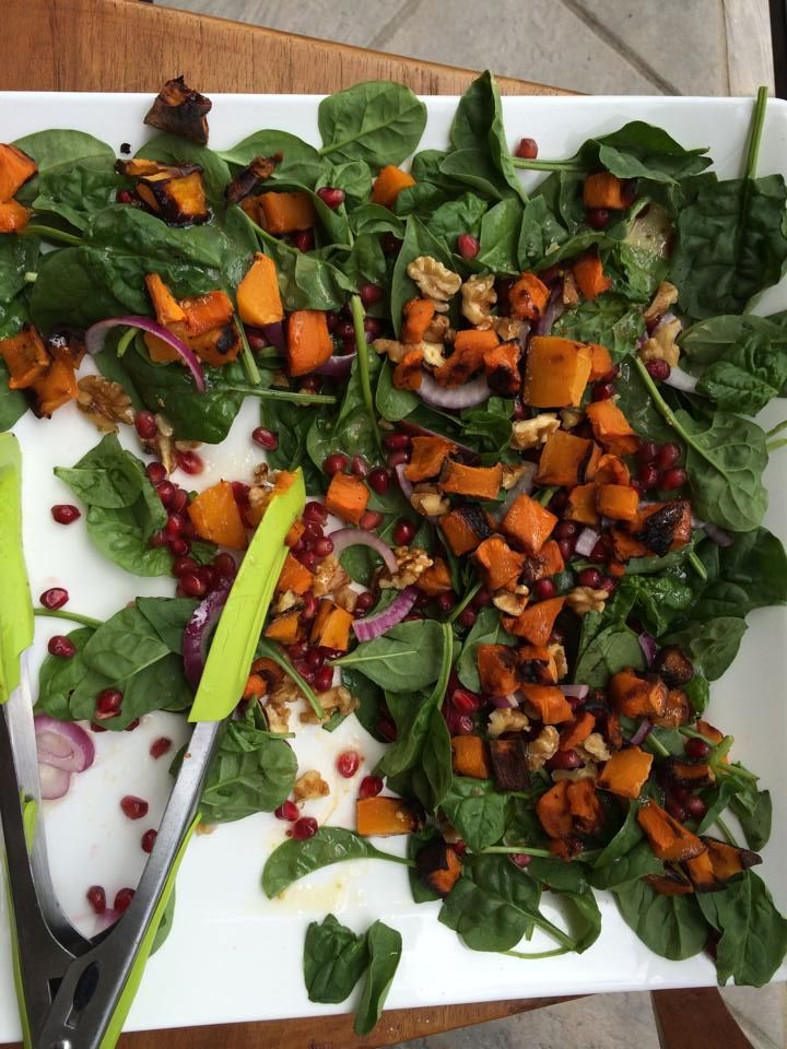 Fresh pumpkin and pomegranate salad bake pumpkin in bite size pieces. Create a bed of spinach. Layer sliced red onion, chopped walnuts, avocado, pumpkin and pomegranate.