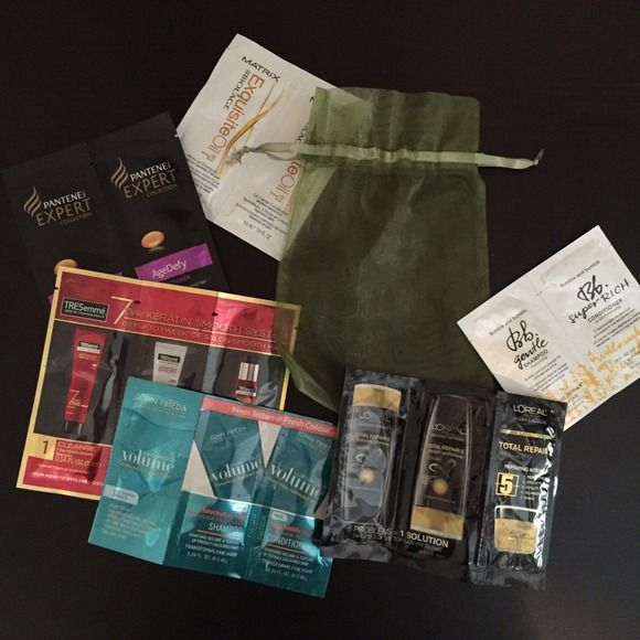 FREE green bag with 6 haircare sample packs Pretty sheer green bag including 6 shampoo, conditioner and product samples pictured. (Pantene age defy, Tresemme keratin smooth, loreal total repair 5, bumble and bumble bb gentle, matrix exquisite oil, John Frieda luxurious volume). Perfect for travel! Free with $20 purchase or $9 Accessories