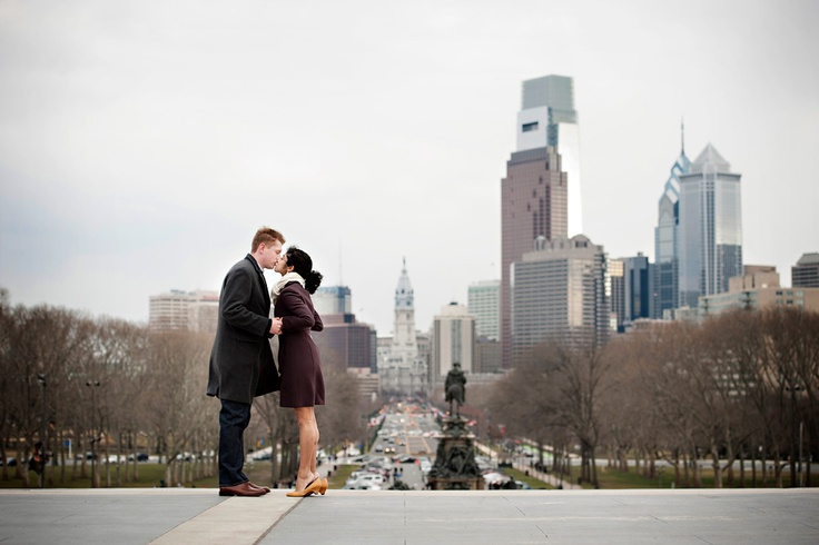Philadelphia engagement session with Neha and Michael. Here, we're at the top of the steps of The Philadelphia Museum of Art made famous by Rocky Balboa / Photo by Maloman Studios