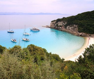 Voutoumi, Anti Paxos, Greece  Voutoumi beach on Anti Paxos is the smallest of the Ionian Islands. To get to the remote crescent of white sand surrounded by steep cliffs, take a short boat ride from Paxos Island.