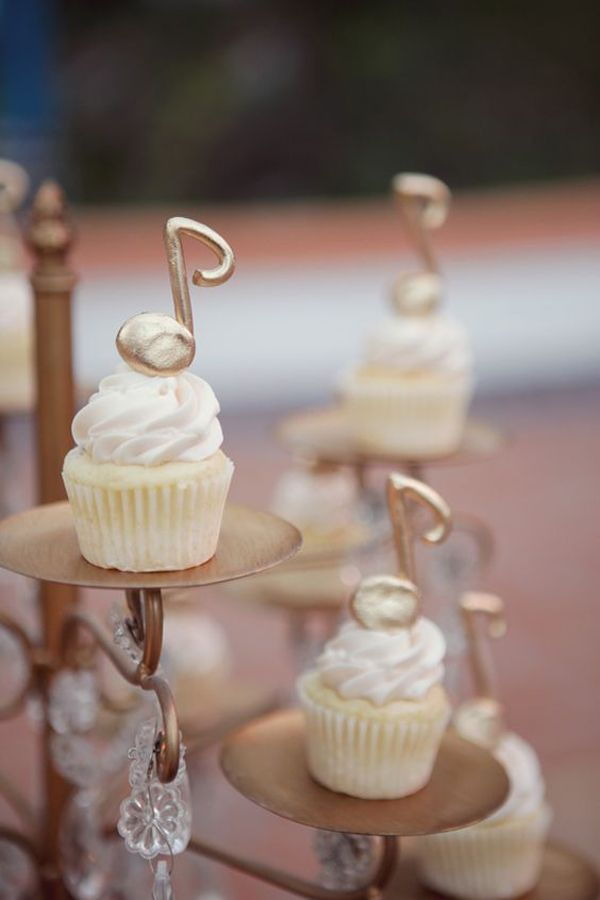 These stunning all white cupcakes topped with bling music notes are setting our cake goals higher!